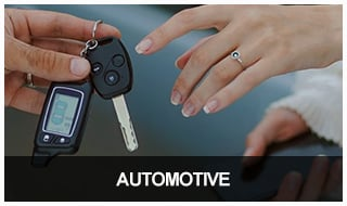 Locksmith handing reprogrammed car remote to customer.