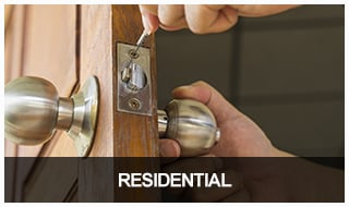 Locksmith installing a residential deadbolt lockset